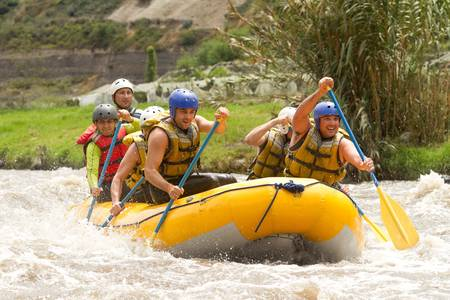 Group of powerful young men on a rafting boat  Patate river , Ecuador
