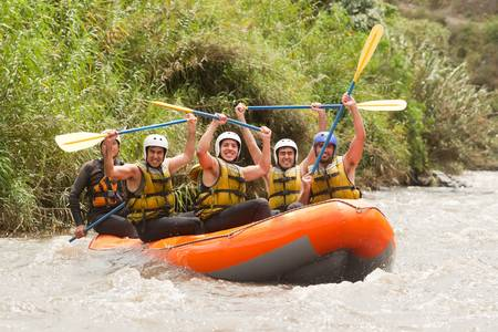 Group of powerfull young men on a rafting boat  Patate river , Ecuador  Shoot with Canon 1D Mark IV from water level