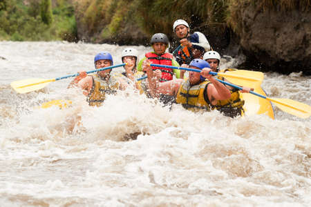 persevere: Group of powerful young men on a rafting boat  Patate river , Ecuador