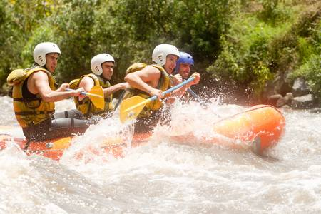 whitewater: Group of powerful young men on a rafting boat  Patate river , Ecuador