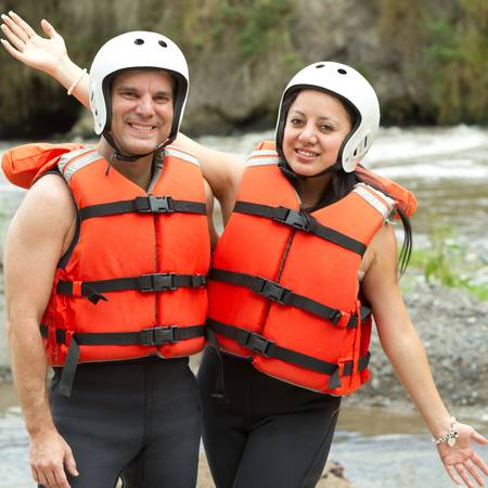 lifejacket: Couple of active persons ready to go rafting  Stock Photo