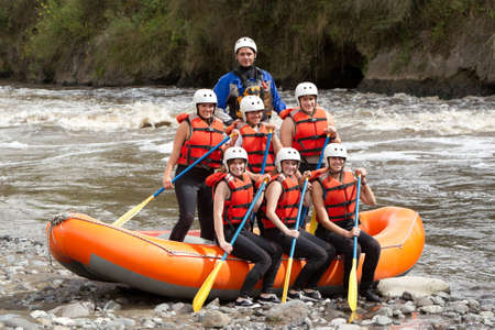 outdoor sports: Large group of young people read to go rafting Stock Photo