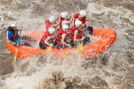 to soak: A group of men and women, with a guide, white water rafting on the Patate river, Ecuador Stock Photo