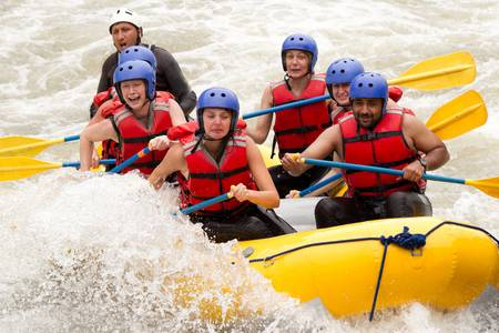 rowing: A group of men and women, with a guide, white water rafting on the Patate river, Ecuador Stock Photo