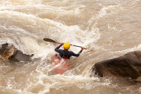 whitewater: an active kayaker on the rough water