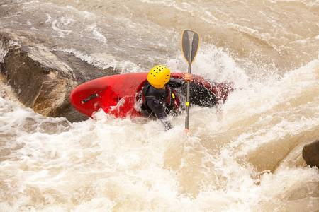 an active kayaker on the rough water photo