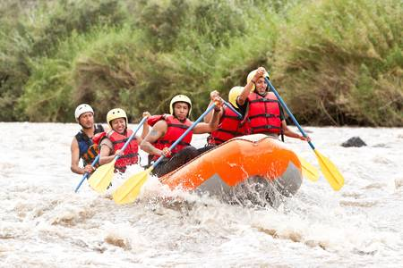 A group of men and women, with a guide, white water rafting on the Patate river, Ecuador Stock Photo - 13698889