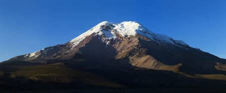 highest: Chimborazo volcano ,Ecuador.While is not the highest mountain by elevation above sea level, its location along the equatorial bulge makes its summit the farthest point on the Earths surface from the Earths center.