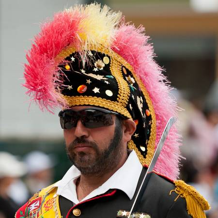 epaulets: Banos de Agua Santa,Ecuador - December 16, 2010 : Man dressed up as an roman legion leader marching on the street during the celebration of town in Banos de Agua Santa,Ecuador - December 16, 2010 Editorial