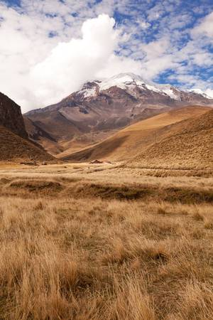 andean: Chimborazo volcano in Ecuador 6,268 meters, its location along the equatorial bulge makes its summit the farthest point on the earths surface from the earths center. Stock Photo