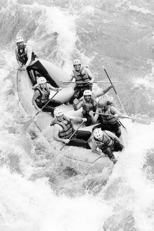 rafting: a group of men and women, with a guide, white water rafting on the Pastaza river, Ecuador ,aerial shot Stock Photo