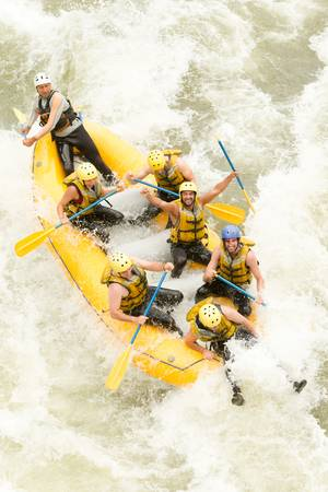 A group of men and women, with a guide, white water rafting on the Pastaza river, Ecuador ,aerial shot Stock Photo