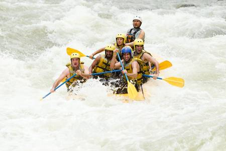 rafting: a group of men and women, with a guide, white water rafting on the Pastaza river, Ecuador