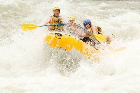 extreme danger: a group of men and women, with a guide, white water rafting on the Pastaza river, Ecuador
