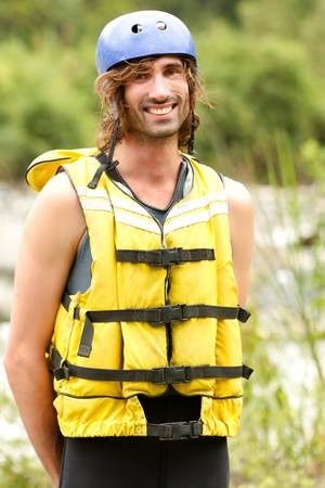 lifejacket: adult man wearing typical water sport outfit