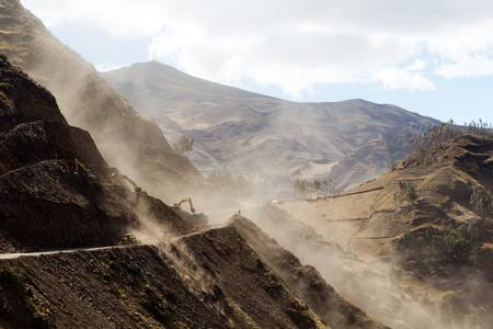 mining machinery: road building in Ecuadorian Andes at high altitude, horizontal.