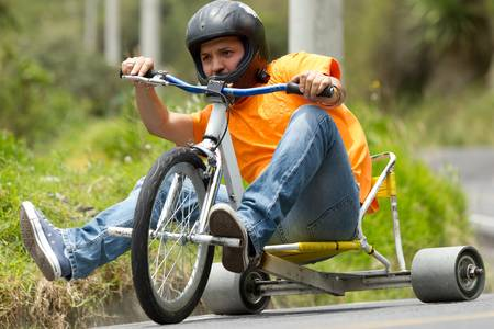 skidding: tike drifting, a new sport begin to take shape, home-made tricycles that have slick rear wheels, normally made from a hard plastic. Stock Photo