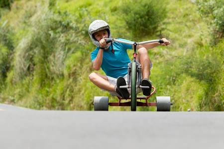 tike drifting, a new sport begin to take shape, home-made tricycles that have slick rear wheels, normally made from a hard plastic. Stock Photo
