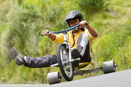 Tike drifting, a new sport begin to take shape, home-made tricycles that have slick rear wheels, normally made from a hard plastic. photo