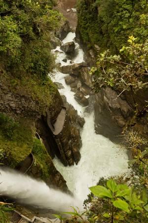 pailon del diablo, devils cauldron in ecuadorian rainforest shoot from a very difficult climbing position. photo