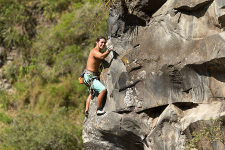 Rock climber climbing up a cliff Stock Photo - 15970904