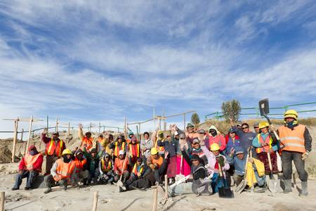developing: Quilotoa,Ecuador - October 1,2012: Group of local builders gathers for a group photo after terminating their objective, during the construction of Quilotoa balcony, a future landmark of this country. Editorial