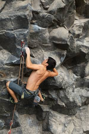 Rock climber shot from the same level. photo