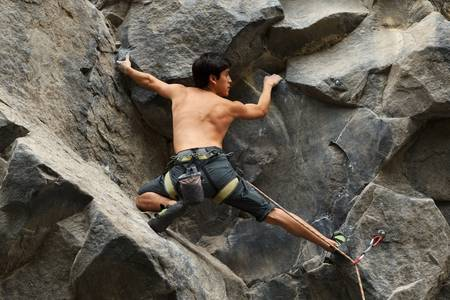 Rock climber searching for a connecting spot Stock Photo - 16250790