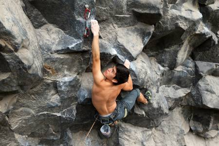 rock climb: Rock climber searching for a connecting spot
