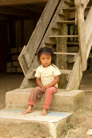 indigence: Portrait of a young indian girl in ecuadorian Amazonia
