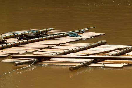 Timber carried down on the river photo