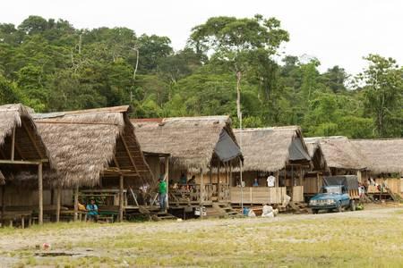 world village: Puni Bocana,Ecuador - November 16,2012: Wood houses in Puni Bocana village, Ecuadorian Amazonia, main street