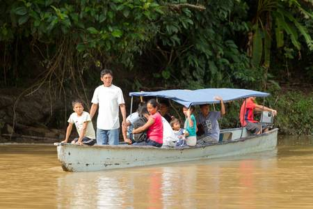 pile engine: Puni Bocana,Ecuador - November 16,2012:Group of people comes to the local food market by canoe, the main trasnportation in Ecuadorian Amazonia Editorial