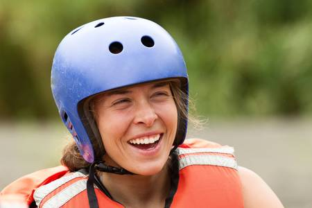 lifejacket: adult woman wearing typical water sport outfit