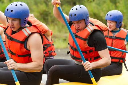 lifejacket: group of young atheltes training for whitewate rafting