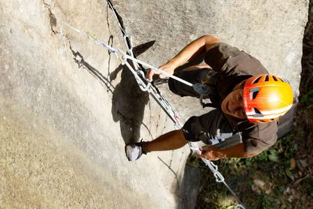 Rock climber closeup, shoot from above Stock Photo