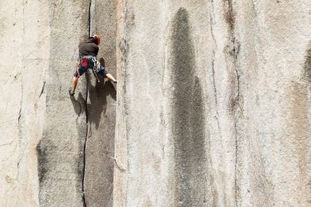 Rock climbing on a perfect vertical plane rock Stock Photo - 16984732