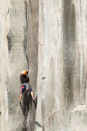 Rock climbing on a perfect vertical plane rock photo