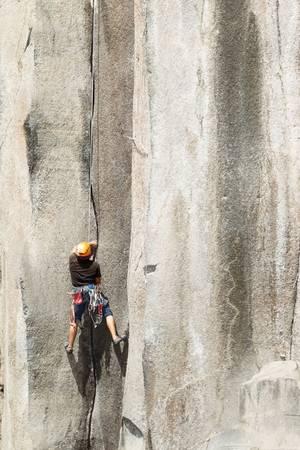 rock climbing on a perfect vertical plane rock Stock Photo - 16984733