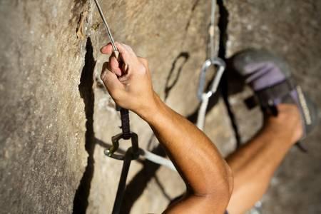 horolezectví abstraktní, ruce a nohy lezce natáčení shora Reklamní fotografie