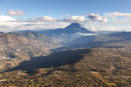 vulcanology: tungurahua province in ecuador, aerial view, volcano with the same name in the background Stock Photo