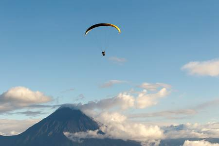 paragliding over tungurahua volcano in ecuador, aerial view photo