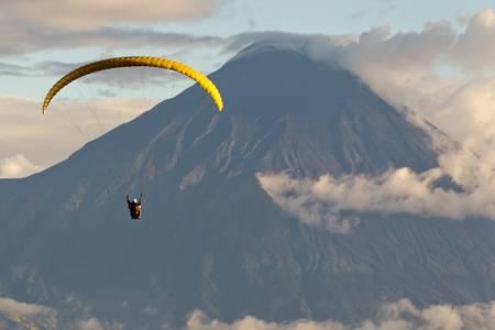 ecuador: paragliding over tungurahua volcano in ecuador, aerial view