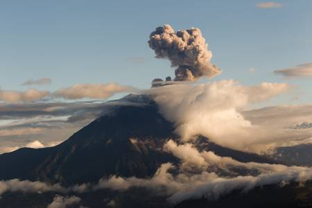 vulcanology: tungurahua volcano explosion at sunset, ecuador, south america Stock Photo