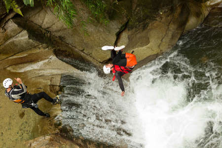 backflip: waterfall backflip in the ecuadorian rainforest Stock Photo