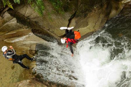 BACKFLIP: waterfall backflip in the ecuadorian rainforest Stock Photo