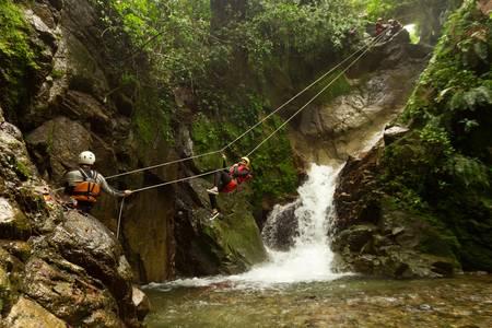 improvized zipline during a canyoning tour in ecuadorian rainforest