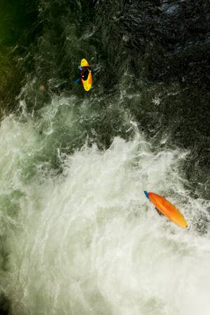 kayaker emerging from underwater after a high jump. photo