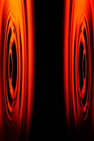 noise pollution: abstract shot of stereo speakers membranes positioned face to face.