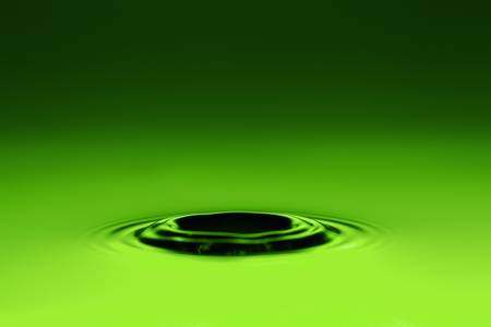 green water hole after a drop splash on green background Stock Photo - 17813745